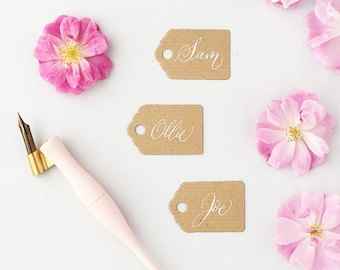 Tiny rustic luggage tags with white calligraphy / wedding place cards / wedding name tags / favour tags / kraft tags for place settings