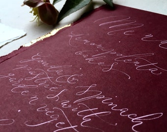 Boho luxe  burgundy wedding menus with gold leaf accents