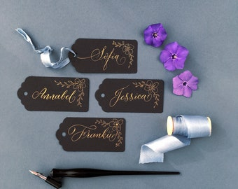 Black wedding favour tags with gold ink and calligraphy