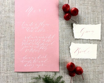 Elegant calligraphy wedding menus on dusky pink textured paper