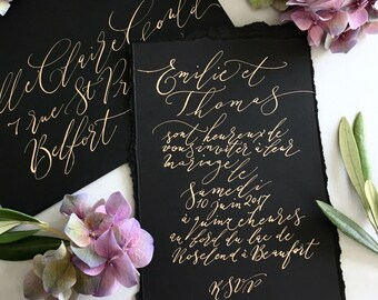 Beautiful black calligraphy wedding invitation with gold ink