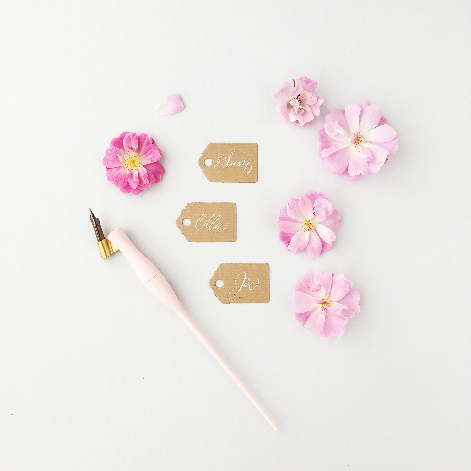 tiny rustic luggage tags with white calligraphy wedding place