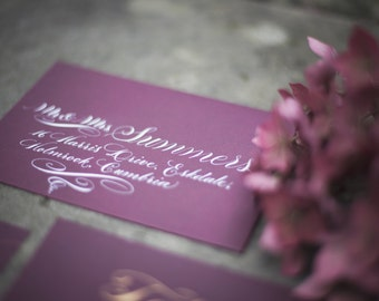 Calligraphy envelope addressing in white ink