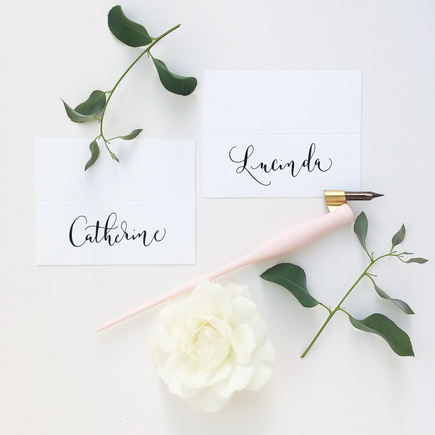 Simple White Wedding Place Names With Modern Calligraphy In Black