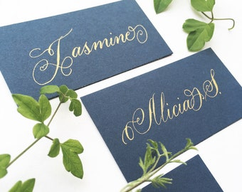 Petrol blue wedding place names with hand calligraphy in gold ink / escort cards / place cards / personalised name cards for weddings