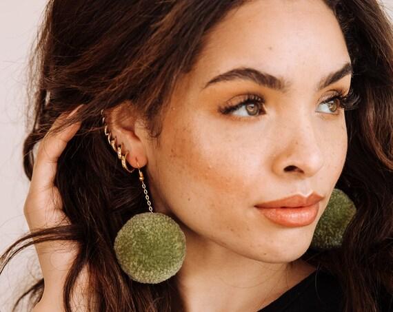 sage pom earrings