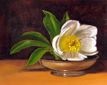 white peony in a silver bowl