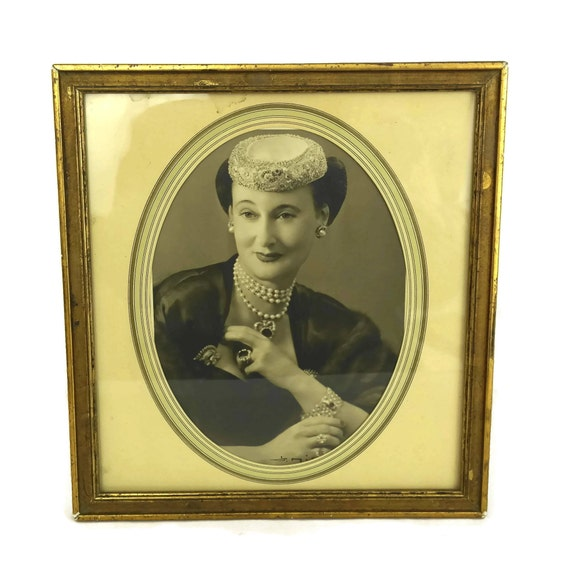 Lady Portrait Photo in Frame wearing 1940s French Fashion and Antique Jewellery. Old Black and White Vintage Woman Studio Art Photography.