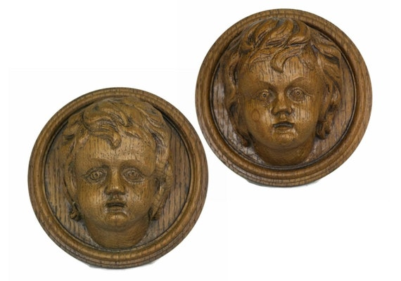 Pair of Antique Wood Carved Cherub Heads.