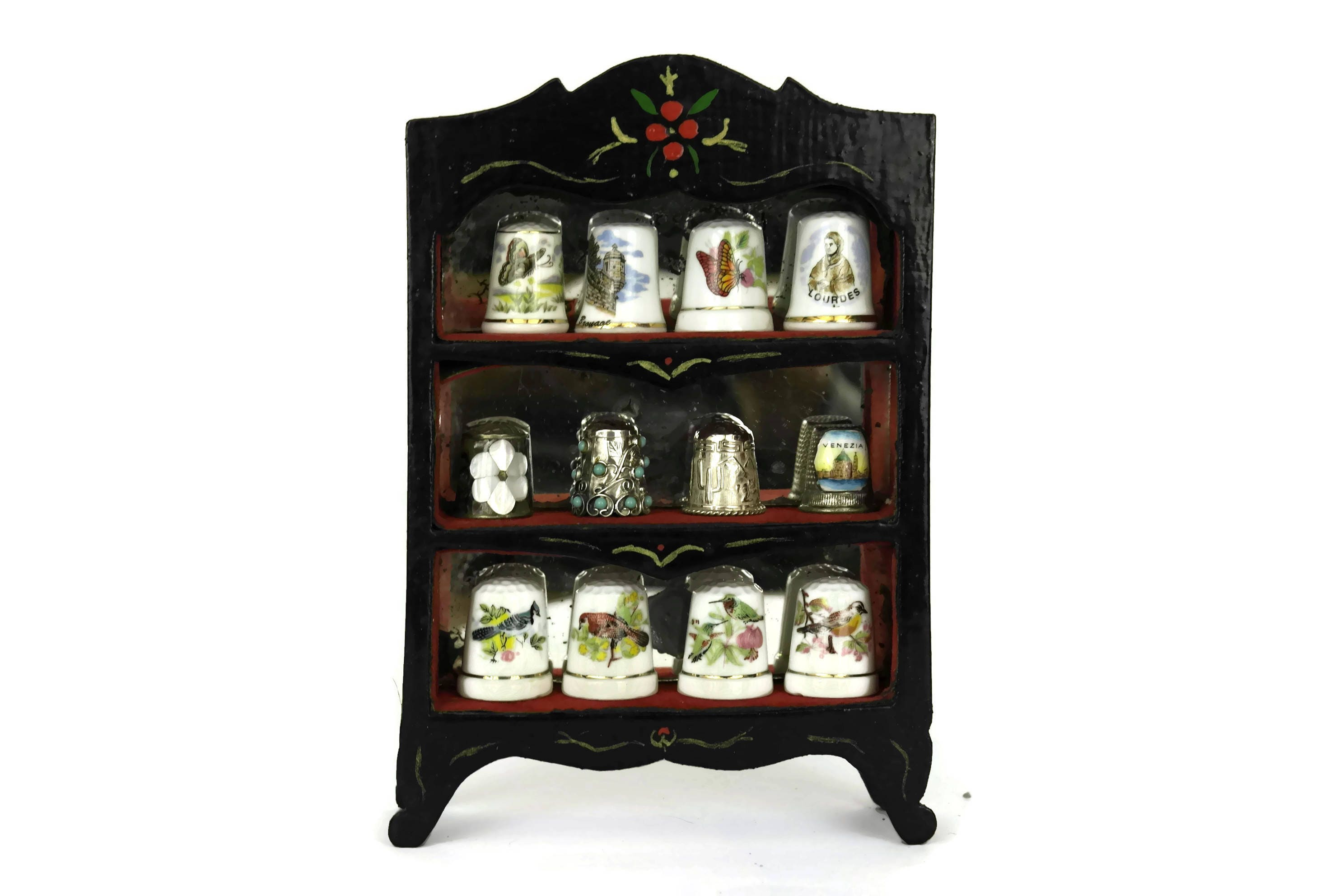 thimble collection in display case. vintage french porcelain and