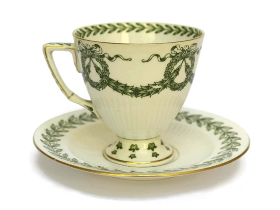 19th Century French Porcelain Cup and Saucer with Green Transferware Wreath Design.