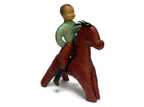 French Vintage Oil Cloth Boy Doll Riding on Horse.