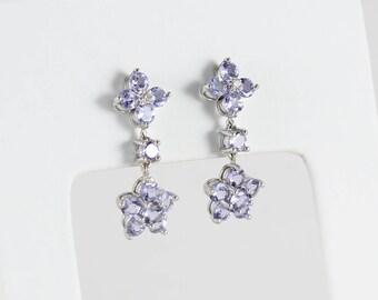 14k White Gold Tanzanite and One Diamond Flower Dangle Drop Earrings
