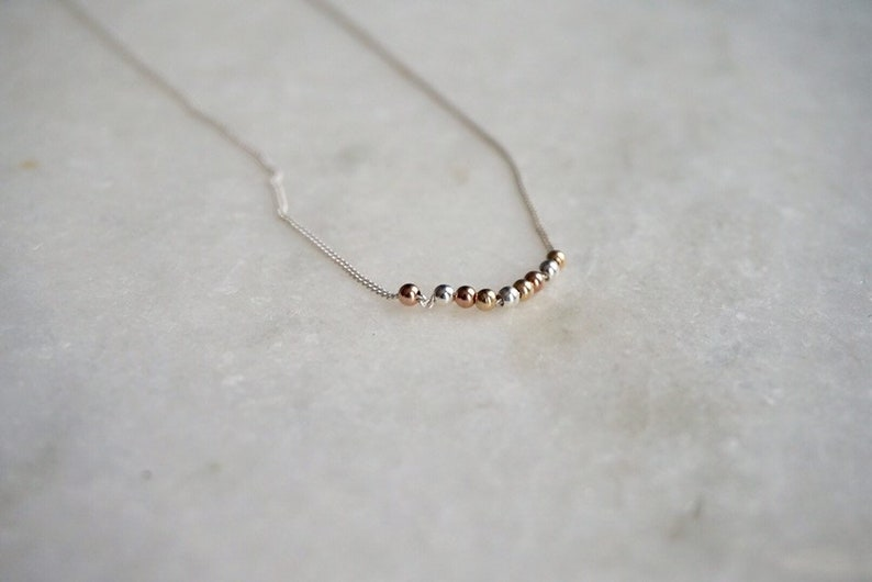 by STICKTAILS MODERATE necklace in sterling and gold filled