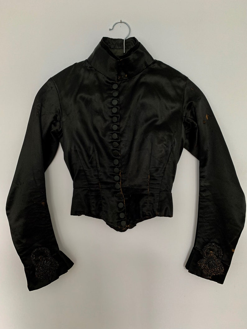 17 Buttons Run Down The Front Vintage Victorian Jacket Black Silk Satin With High Neck Very Small Size. Black Jet Beading On Sleeves