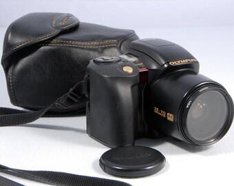 Olympus IS-10 Super DLX 35mm full auto SLR film camera