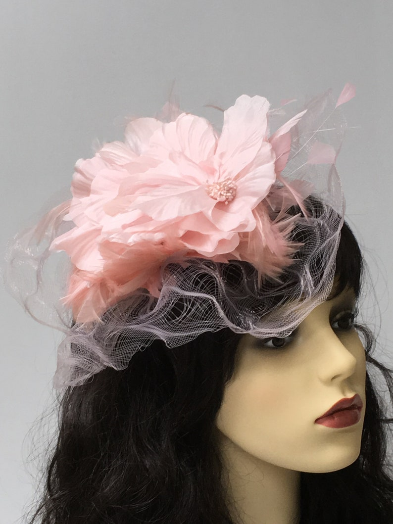 Pale pink crinoline fascinator