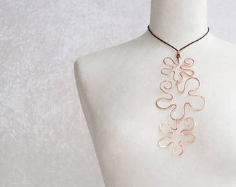 A copper pendant necklace handmade wire wrapped with three shapes of flowers, an unique piece of copper jewelry for womens