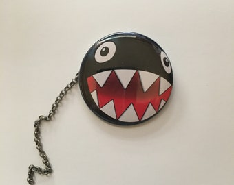 Chained Bomb Pin back button
