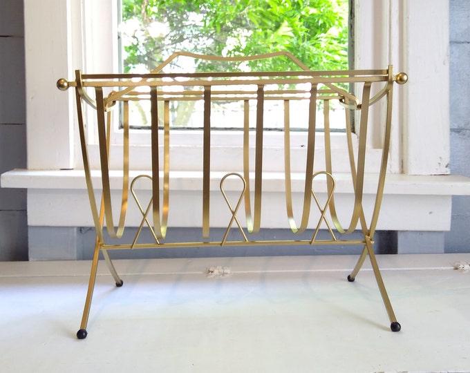 Featured listing image: Vintage MidCentury Modern Magazine Rack Standing Metal Footed Swinging Basket Design Brass Color Living Room Decor RhymeswithDaughter