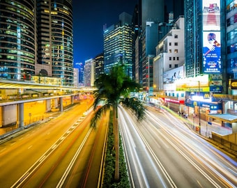 Long exposure of traffic on Connaught Road and skyscrapers at night, in Hong Kong. Photo Print, Metal, Canvas, Framed.