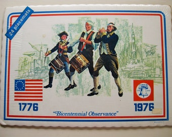 """4th of July. 24 Bicentennial paper placemats still in wraps. """"Bicentennial Observance"""" Red, white, blue. Patriotism."""