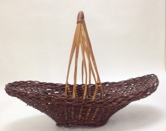"long and unique off center large basket with tall handle; oval bread serving tray basket display, 19""x7"" wide, 4"" deep, 13"" tall yesteryears"