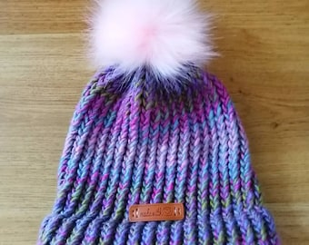 Multicolor knitted beanie/hat with removable pink faux fur pom pom