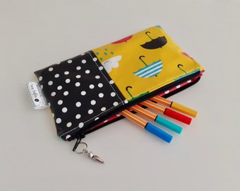 Umbrellas, clouds and polkadots wipe clean pencil case