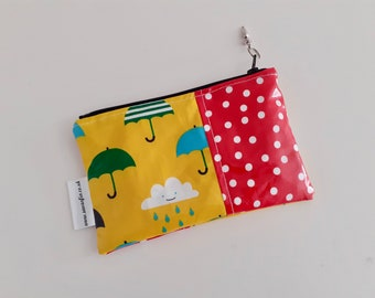 Umbrellas, clouds and polkadots wipe clean zip pouch