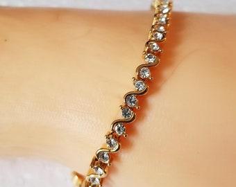 PD Gold tone clear stones tennis bracelet