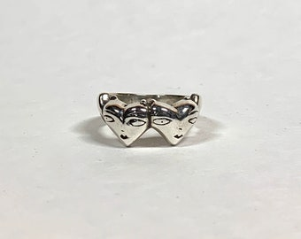 Hand made winged hearts sterling silver ring