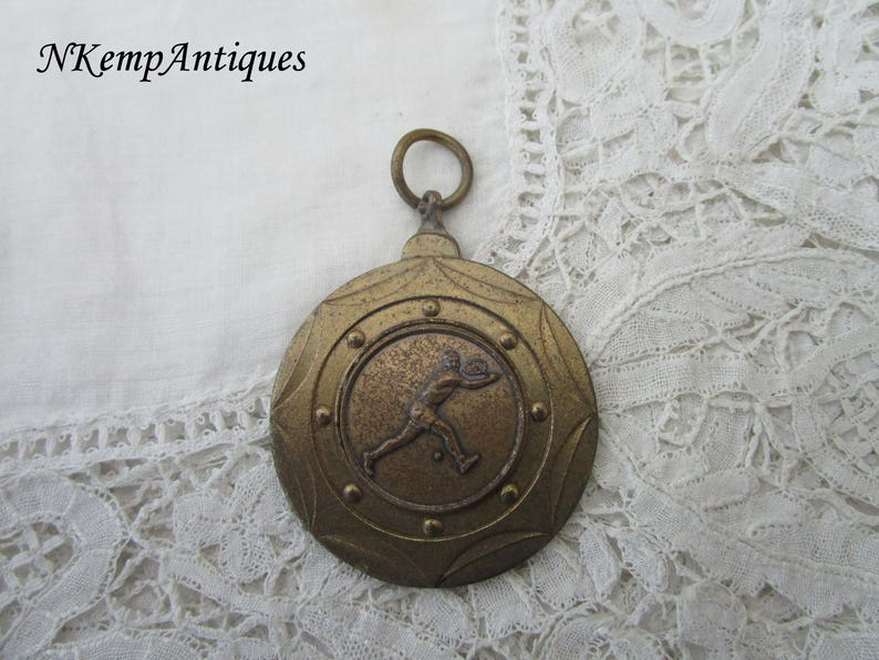 Vintage tennis medal