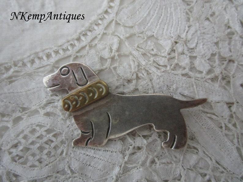 Silver dog brooch