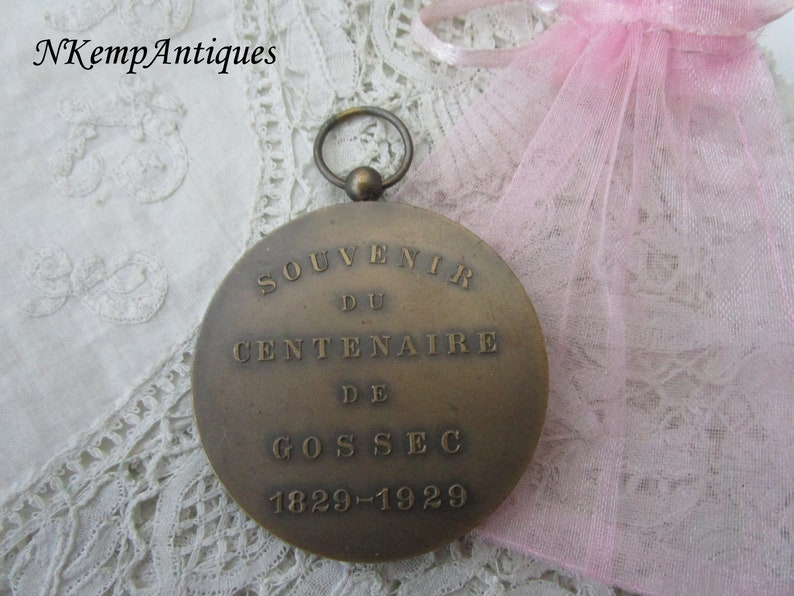 Old medal pendant signed