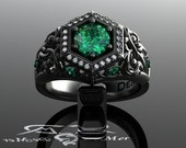 Unique emerald engagement ring in black gold. Art Deco halo and Victorian Gothic filigree scrollwork with ideal cut diamonds. Corvus Ring.