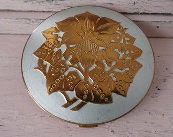 Pygmalion compact etsy vintage pygmalion made in england embossed powder compact no 1979 gumiabroncs Gallery
