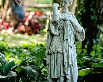 I am Strong, statue in a garden photograph