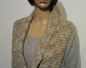 Knitted Möbiusschal as a collar made of Ribbon yarn with silk