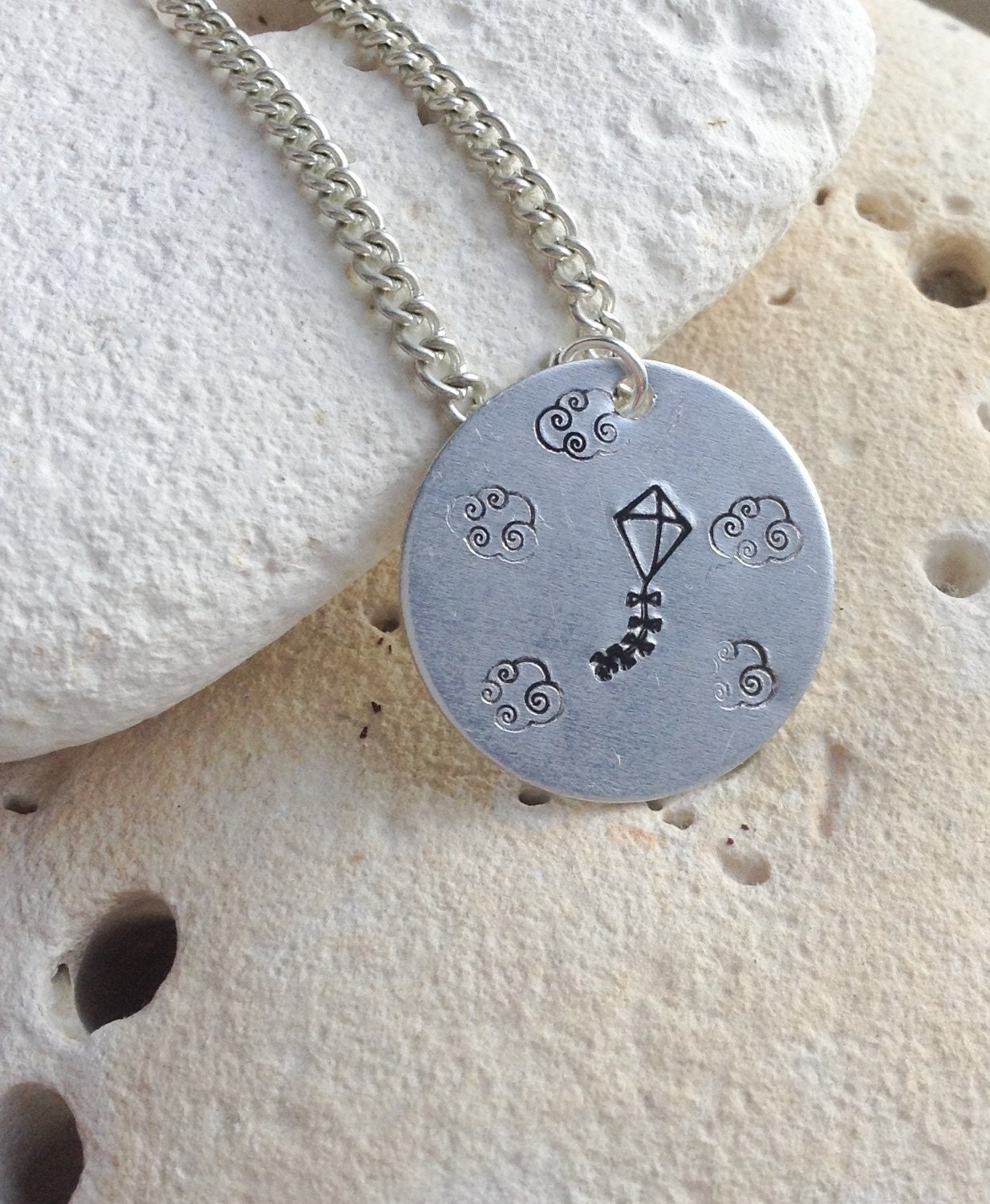 """Flying kite in the sky with clouds picture pendant on 18"""" chain."""