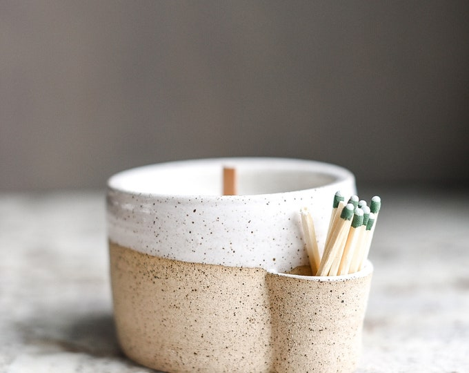 Match strike ceramic candle holder with hand poured, amber scented soy candle