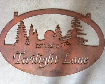 TWILIGHT LANE metal sign with evergreens and setting sun