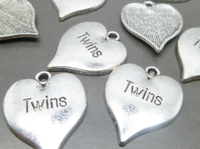 4 Big Sister charms antique silver tone M35