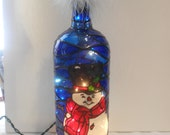Snowman Inspired Stained Glass look Lighted Handpainted Wine Bottle