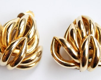 Gold tone leaf clip on earrings