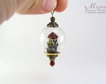 Miniature world pendant, miniature little house on top of a hill under glass dome