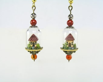 Miniature world earrings, miniature little houses with tiny amidst flowering bushes under glass dome