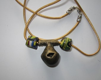 Necklace composed of 19th. C or earlier Benin Bronze Lost Wax Bell Pendant and 19th. C.Venetian Millifiori Bead