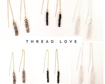 Delicate thread earrings with stacked gems