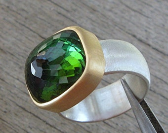 green tourmaline ring in gold and silver.